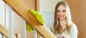 woman-cleaning-wooden-stair
